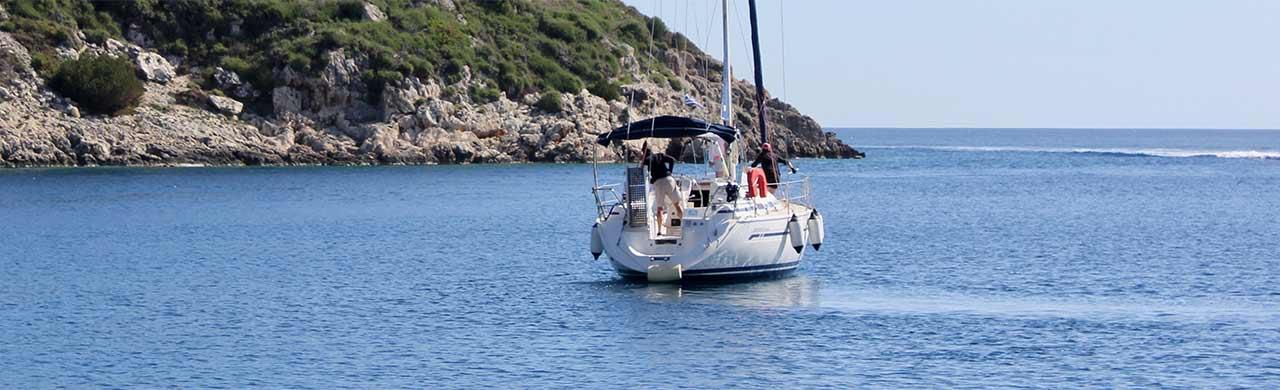 Flotilla Yacht Leaving Harbour in Greece