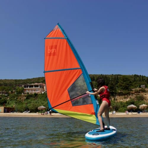 A girl trying windsurfing