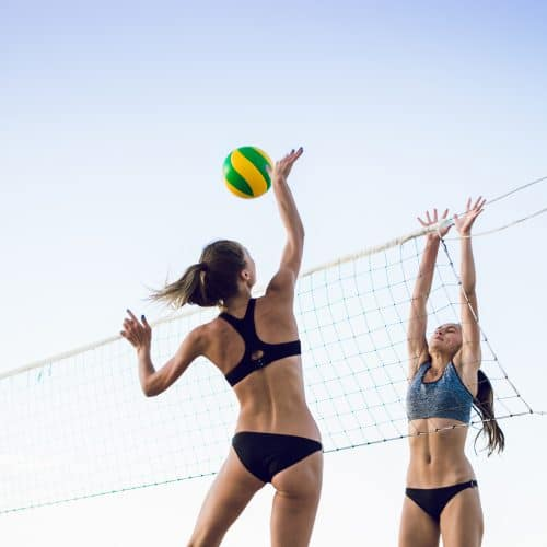 3 people playing volleyball