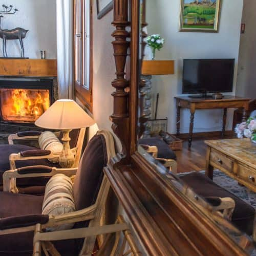 Chalet Lucette wood burner and chairs