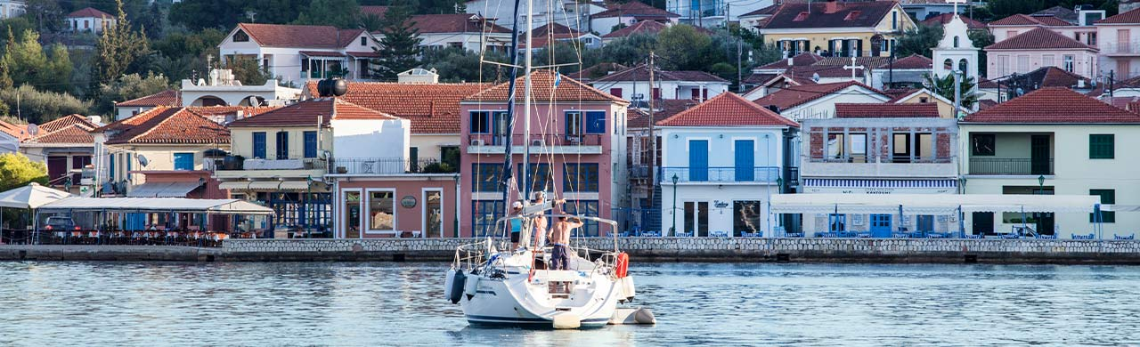 Yacht arriving to harbour in Greece